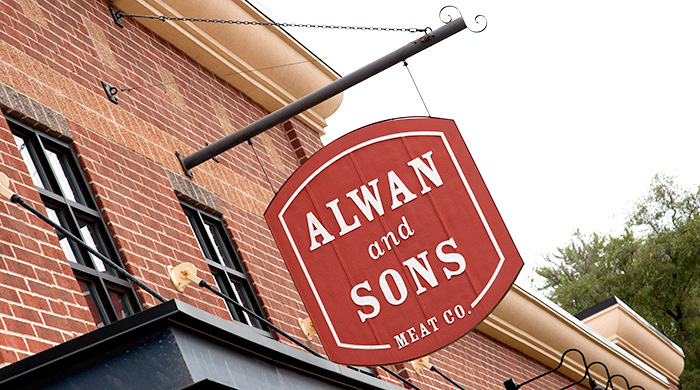 Outdoor logo and sign at Alwan and Sons location