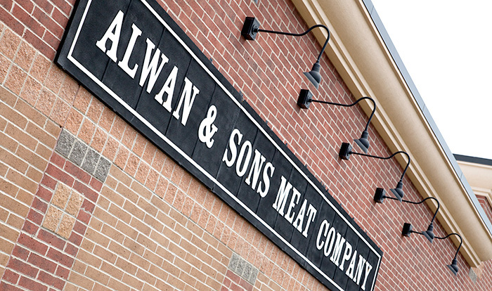 Outdoor signage at Alwan and Sons location